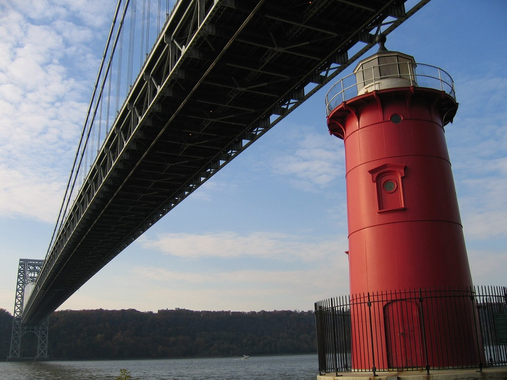 The little red lighthouse that now sits in the shadow of the Washington Bridge, might be tiny, but it played a big role in helping guide many a ship. Photo credit Flickr user CPW View.